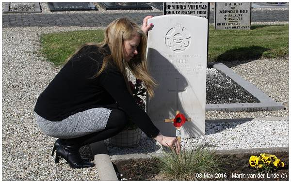 Brenda Gibbs (niece) puts poppy on Uncle Jack's grave - 03 May 2016