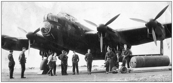 Sgt. John Johnstone Sloan - 3rd Right - in front Lancaster K2 - likely 1943