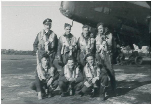 Crew with Nav. Newman - on the left standing - likely with crew Hunter - crop photo