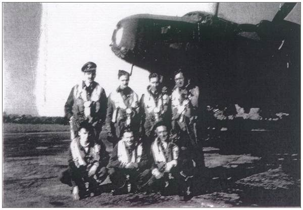 Crew with Nav. Newman - on the left standing - likely with crew Hunter - xerox