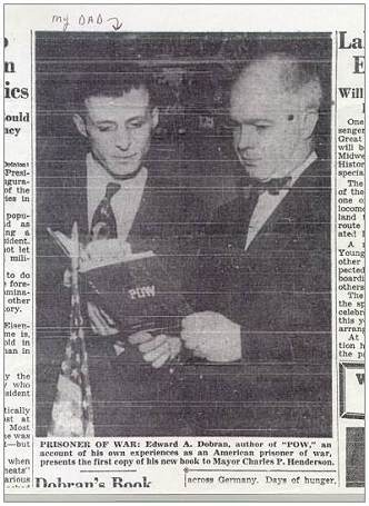 Edward A. Dobran presents his 'P.O.W.' book to Mayor Charles P. Henderson
