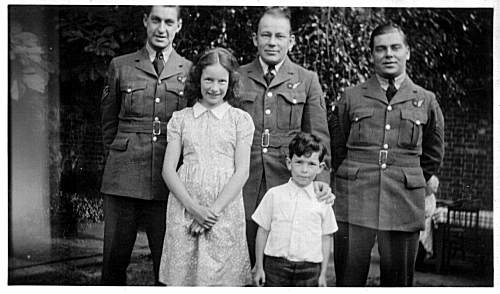 Ed Crothers (left), with unknown Airmates and children