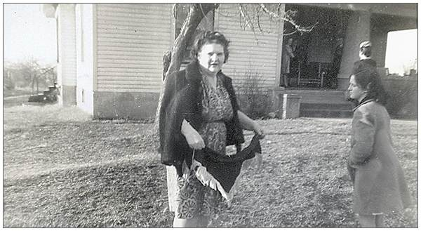 Mrs. Mae S. Thompson with her daughter Dixie in front of their home in Dyer