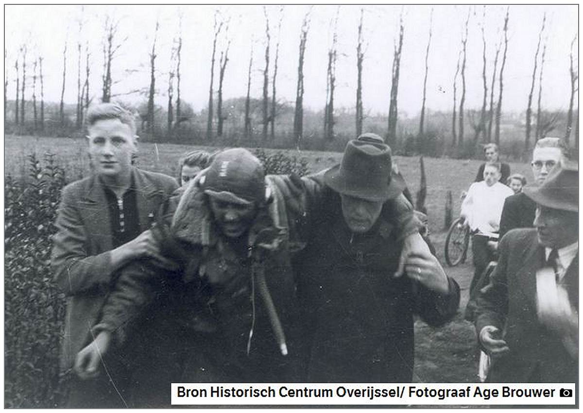 Injured S/Sgt. Harlan Shoemaker Mann supports by local residents - Tuesday 11 Jan 1944
