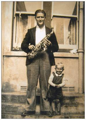 Jack posing with saxophone - child unknown