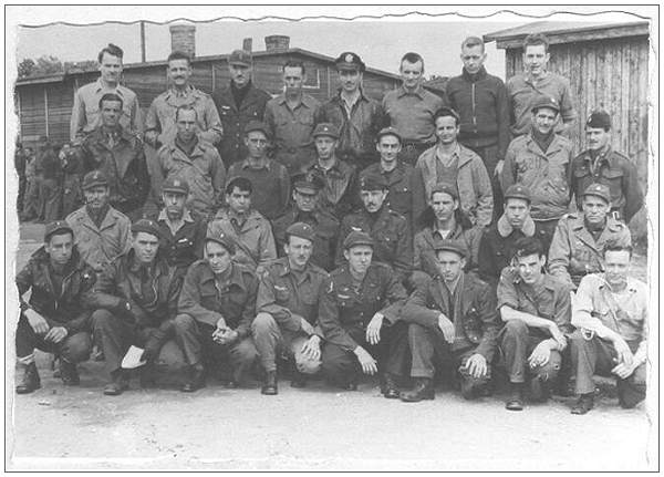 William 'Bud' O'Barr - likely in this POW Camp photo - front row at the right