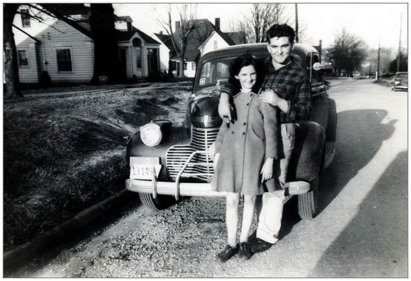Milton with his sister Dixie in front of Pontiac GM, Dyer